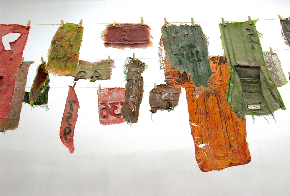 Laundry Day, 2010, Latex, pigent, cheesecloth, detritus from abandoned homes in Buffalo, dimensions variable, each piece approximately 6 x 24 inches