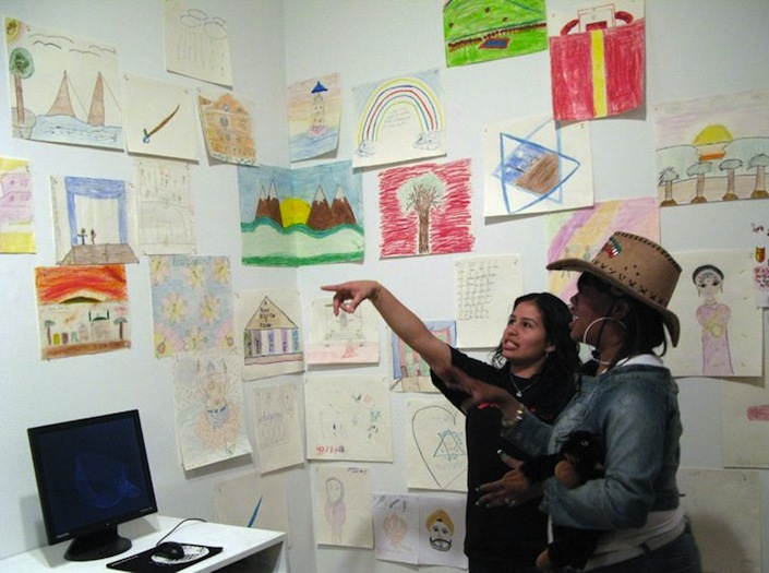 Queens Teens guiding visitors through the kids' drawing installed at the Queens Museum of Art