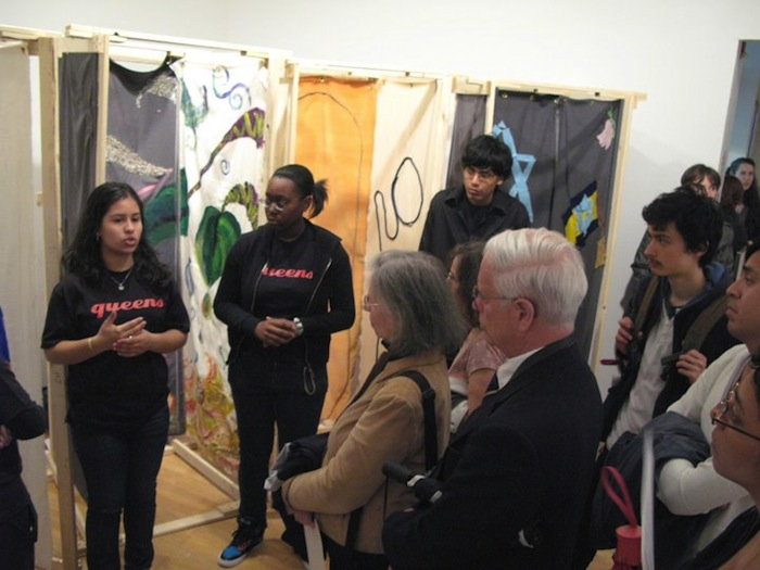 Queens Teens guiding visitors through the installation at the Queens Museum of Art
