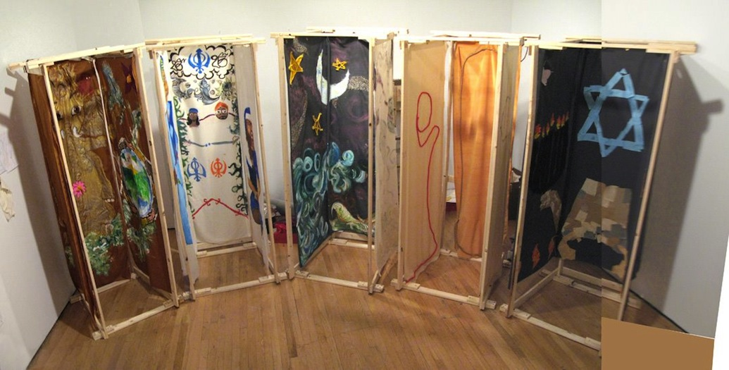 Booths designed by the Queens Teens based on kids' drawings, installed at Queens Museum of Art